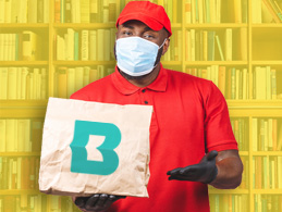 image of a library employee with mask delivering items in a bag